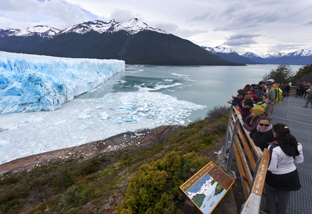 Calafate, Argentina-Novembrer 23, 2014: People watching the collapses on the glacier located in the Los Glaciares National Park in the south west of Santa Cruz province, Argentina.