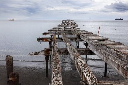 The remains of an old pier, now a resting place for seabirds. Sand Point, Chilean Patagonia.