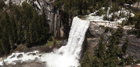 Tourists flock to Lower Yosemite Falls in Yosemite National Park on a Spring afternoon.