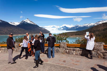 Calafate, Argentina-Novembrer 23, 2014: People watching the Los Glaciares National Park in the south west of Santa Cruz province, Argentina.