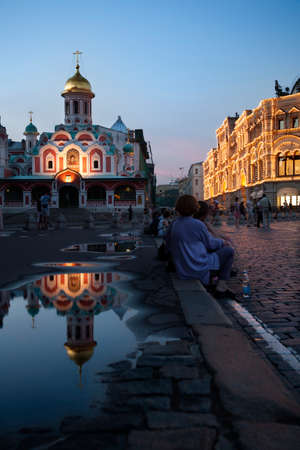 Moscow, Russia-July 20, 2010. Dozens of travelers, walk through Red Square in Moscow and a chance to visit and photograph the cathedral St. Basil on sunset