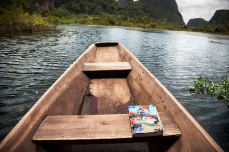 Laos, July 26, 2009: Sailing in a canoe through an area flooded by the latest monsoon rains in Laos Editoriali