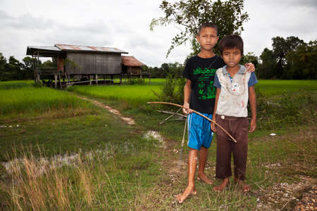 Don Khong, Laos. July 31, 2009:Children leave their house to hunt with bow and arrow Editoriali