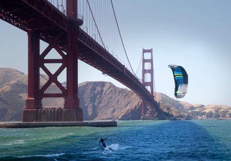 San Francisco, USA: June 22, 2017: Kitesurf under the Golden Gate Bridge. San Francisco, California