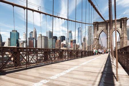 Manhattan, USA-June 6, 2017: Tourists Crossing the Brooklyn bridge towards manhattan