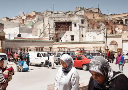 Fez, Morocco-April 24, 2014: Group of people sitting in a wedding shops wating customers during a nice spring morning in the Medina of Fez