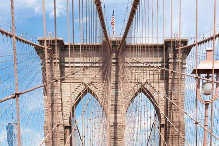 Brooklyn bridge with de American flag on the top Banco de Imagens - 157547934