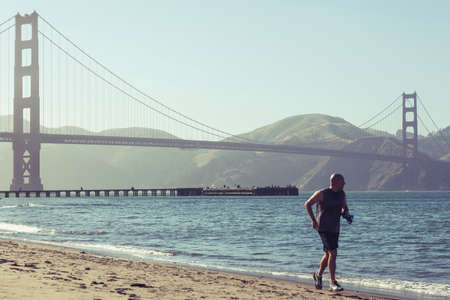 San Francisco, USA- June 22, 2017: Running and playing in San Francisco bay with his pet
