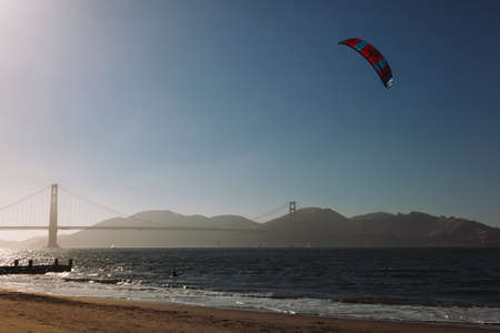 San Franciso, CA, USA-June 22, 2017: Kitesurfing under the Golden Gate Bridge. San francisco California