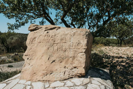 La Fatarella, Spain-April 18, 2021: Stone carved with the name of the Battalion that was in that same place during the Battle of the Ebro in the Sierra de la Fatarella. Tarragona province