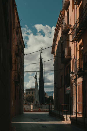 Tortosa, Spain-October 12, 2020: At the end of a street in the old town of Tortosa you can see the Francoist monument to those who died in the Battle of the Ebro. This monument will be removed next July in compliance with the Law of Historical Memory