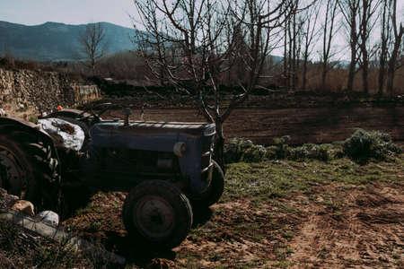 Old tractor in a field of Matarranya. Teruel province. Spain