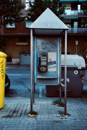 Badalona, Spain-May 18, 2021: The last phone booths that were put on the street in the last 20th century have already been totally obsolete and forgotten