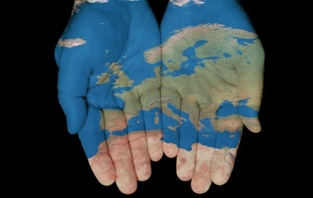 Map painted on hands showing concept of having Europe in our hands  Zdjęcie Seryjne