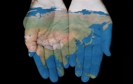 Map painted on hands showing concept of having Asia in our hands