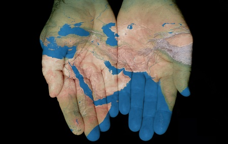 Map painted on hands showing concept of having the Middle East in our hands  版權商用圖片