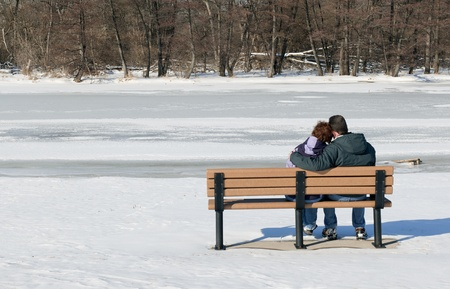 Couple Sitting On Bench In Winter Stock Photo - 11276040