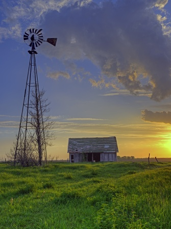 Old Abandoned Barn At Sunset photo