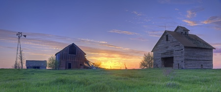 Abandoned Farmhouse And Barns At Sunset photo