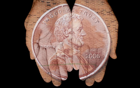Brick Image Of A Penny On A Pair Of Hands photo