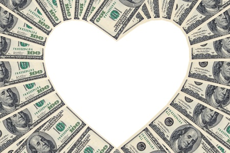 Hundred Dollar Bills Forming A Heart Shape On A White Background