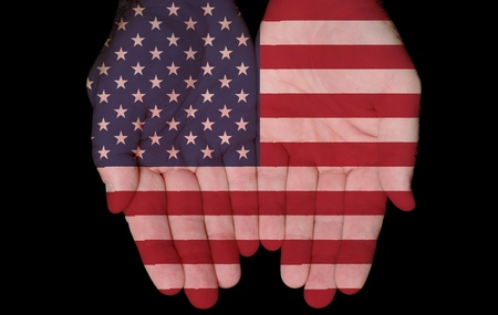 American Flag On Hands With Concept Of America In Our Hands Stock Photo