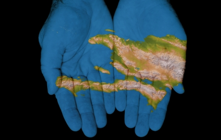 haiti: Map painted on hands showing concept of having Haiti in our hands Stock Photo