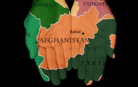 afghanistan: Map Painted On Hands Showing The Concept Of Having Afghanistan In Our Hands