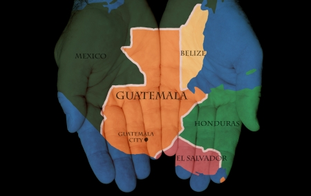 guatemala: Map Painted On Hands Showing The Concept Of Having Guatemala In Our Hands