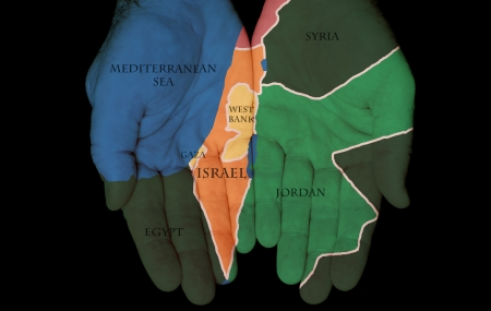 Map Painted On Hands Showing The Concept Of Israel and Palestine In The Hands Of The People Stock Photo