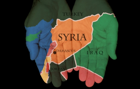Map Painted On Hands Showing The Concept Of Syria In The Hands Of The People