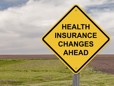 Caution Sign - Health Insurance Changes Ahead Stock Photo