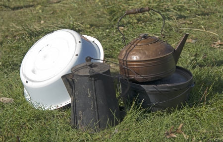 Still Life Of Old Pots And Pans Outdoors photo