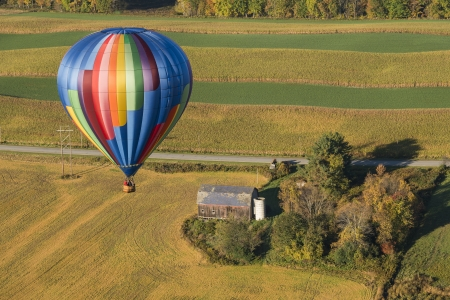 Hot Air Balloon Flying Over The Farm Landscape In Beautiful New York State Stock Photo