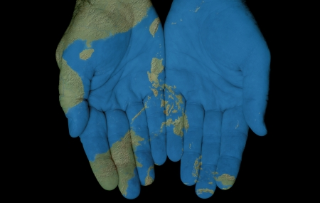 philippines map: Map painted on hands showing concept of having the Philippine Islands in our hands Stock Photo
