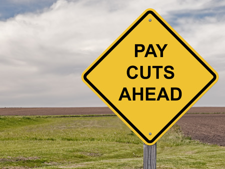pay cuts: Caution Sign - Pay Cuts Ahead