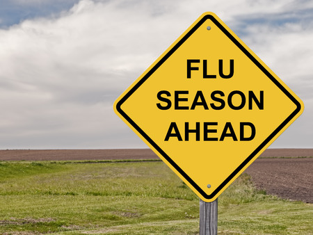 risks ahead: Caution Sign - Flu Season Ahead Stock Photo