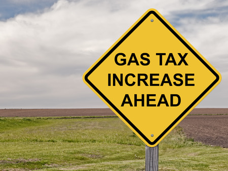 Caution Sign - Gas Tax Increase Ahead Stock Photo