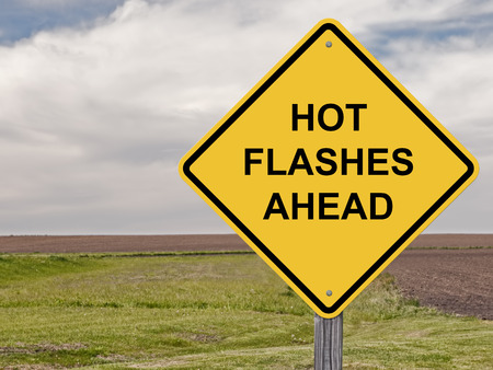 Caution Sign - Hot Flashes Ahead Stock Photo