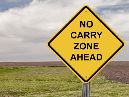 Caution Sign - No Carry Zone Ahead Фото со стока