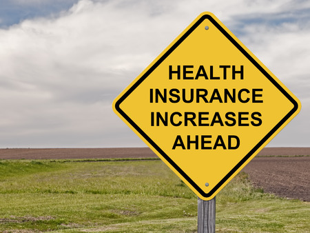 Caution Sign - Health Insurance Increases Ahead Stock Photo