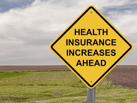 Pozor Sign - Zdravotní pojištění Zvyšuje Ahead Reklamní fotografie