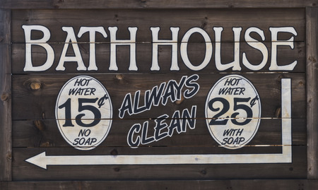 old sign: Old West Bathhouse Sign