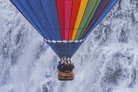 descending: Hot Air Balloon descending in front of the Middle Falls at Letchworth State Park in New York