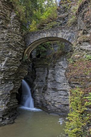 sentry: Waterfall Under Sentry Bridge in Watkins Glen State Park In New York