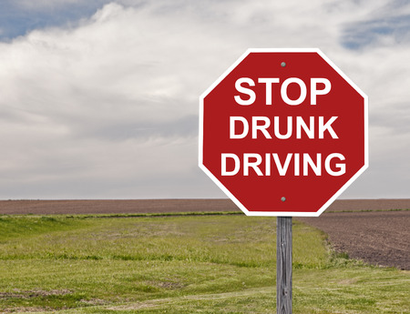 drunk driving: Stop Sign Asking To Halt Drunk Driving Stock Photo