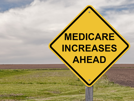 medicare: Caution Sign - Medicare Increases Ahead Stock Photo