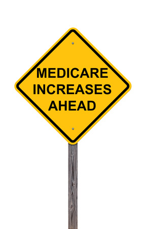 Caution Sign Isolated On White - Medicare Increases Ahead Stock Photo
