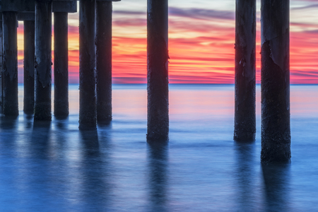 augustine: Under The Pier At Sunrise In St. Augustine Florida Stock Photo