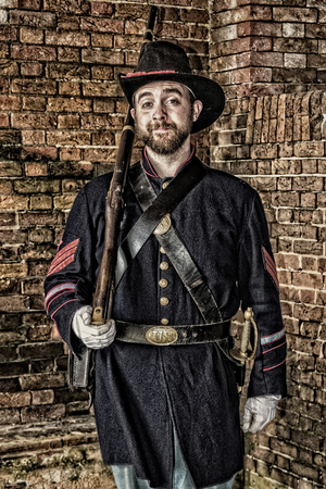 GULF SHORES, ALABAMA, USA - FEBRUARY 6, 2017: re-enactors in period dress and uniform demonstrated US Civil War era living at Fort Fort Morgan Beach
